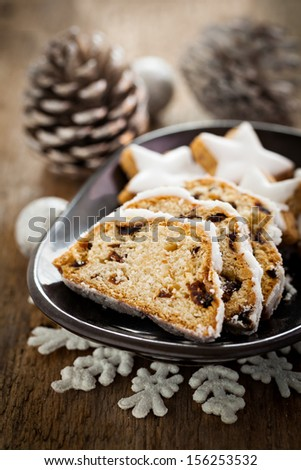 german stollen cake with raisins and cookies   - stock photo
