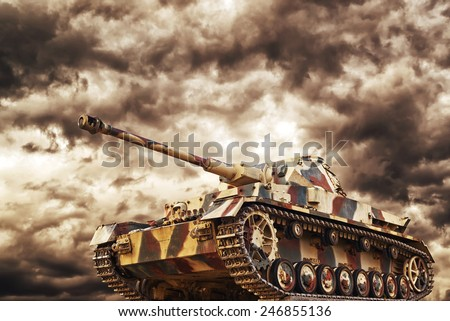 German Tank in action with dark storm clouds in background, Concept of war and conflict. - stock photo