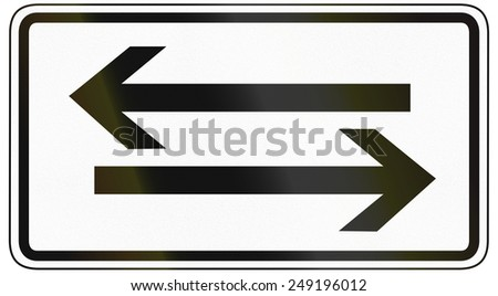 German traffic sign additional panel to specify the meaning of other signs: Crossing road both ways. - stock photo