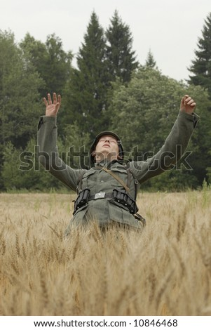 German WW2 infantery soldier, just wounded in action - stock photo
