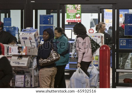 GERMANTOWN - NOVEMBER 26: Walmart black friday shoppers start at 12AM November 26 2010, MD, 2010 in Germantown, Maryland - stock photo
