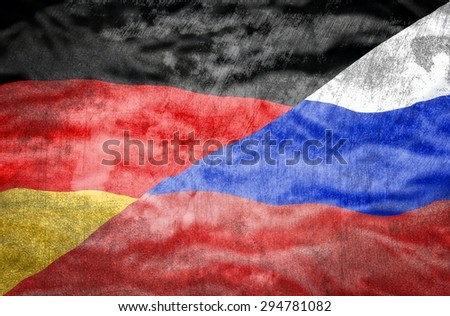 Germany and Russia mixed flag. Germany and Russia flag overlaid with grunge texture. - stock photo
