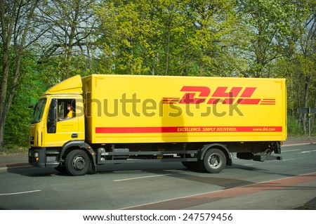 GERMANY - APR 3: DHL Iveco Euro Cargo truck on Apr. 3, 2014 in Germany. DHL is the world's largest logistics company operating around the world. DHL is a world market leader in sea and air mail. - stock photo