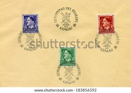 GERMANY - APRIL 20, 1943: 3 German stamps for celebration of Adolf Hitler birthday - sheet - show portrait of Adolf Hitler, canceled in Krakow during nazi occupation - stock photo