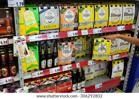 GERMANY - AUGUST 11: Beer aisle with Radler of different German breweries. Radler, the name of a mixture drink 50:50 of beer and sparkling lemonade. Taken in a Kaufland supermarket on August 11, 2015 - stock photo