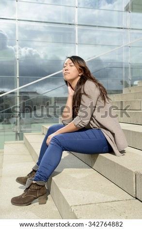 Germany, Berlin, young female tourist sunbathing on steps