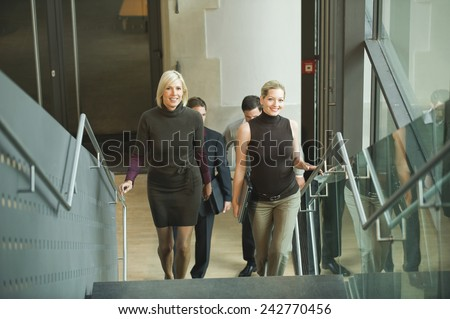 Germany, business people climbing stairs, elevated view