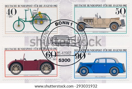 GERMANY - CIRCA 1982: A  first day of issue postmark printed in Germany, shows Antique Cars Benz 1886, Mercedes 1913, Hanomag 1925, Opel Olympia 1937, circa 1982 - stock photo