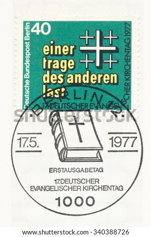 GERMANY - CIRCA 1977: A  first day of issue postmark printed in Germany, shows Bear each others burdens, 17th meeting of German Protestants (Evangelical Synod), Berlin, circa 1977 - stock photo