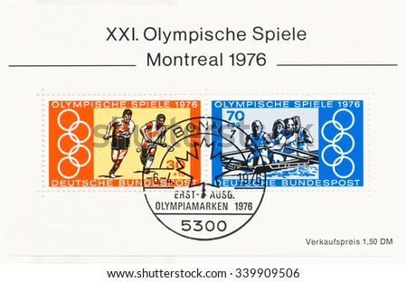 GERMANY - CIRCA 1976: A  first day of issue postmark printed in Germany, shows Hockey, Rowing, coxed four and Olympic Rings, Montreal, Canada, July 17-Aug. 1. Sports Aid Foundation, circa 1976 - stock photo