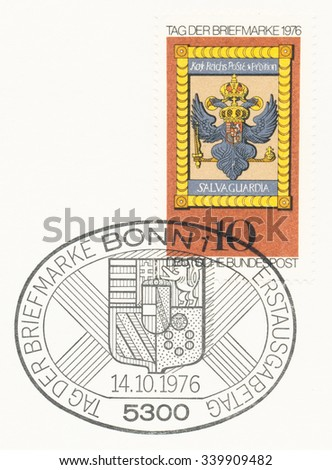 GERMANY - CIRCA 1976: A  first day of issue postmark printed in Germany, shows Imperial Post Emblem, Hochst am Main, 18th Cent., circa 1976 - stock photo