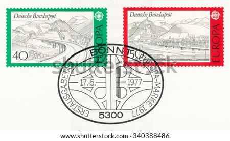 GERMANY - CIRCA 1977: A  first day of issue postmark printed in Germany, shows Rhon Highway, Rhine, Siebengebirge and train, circa 1977 - stock photo