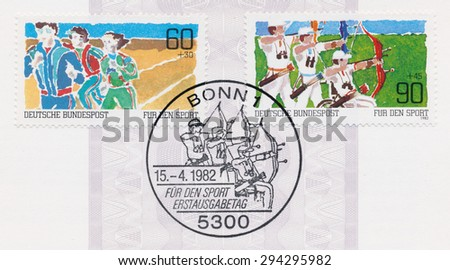 GERMANY - CIRCA 1982: A  first day of issue postmark printed in Germany, shows runners and archers, circa 1982 - stock photo
