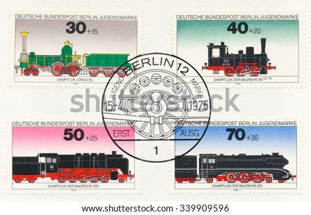 GERMANY - CIRCA 1975: A  first day of issue postmark printed in Germany, shows Steam Locomotives: Dragon, Class 89 (70-75), Class O50, Class O10, circa 1975 - stock photo