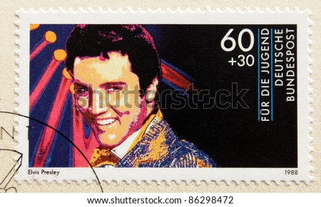 GERMANY - CIRCA 1988. A postage stamp printed in Germany shows image portrait of famous American singer Elvis Presley (1935-1977), circa 1988. - stock photo