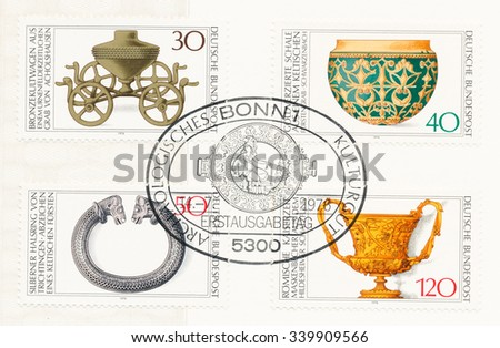 GERMANY - CIRCA 1976: A  postmark printed in Germany, shows  Bronze Ritual Chariot 1000 B.C., Celtic gold vessel, 5-4 B.C., Celtic silver torque, 2-1 B.C., Roman cup with masks, 1AD., circa 1976 - stock photo