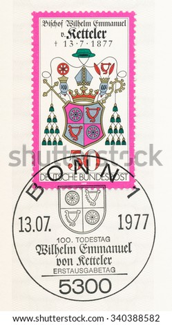 GERMANY - CIRCA 1977: A postmark printed in Germany, shows Coat of Arms, Wilhelm Emmanuel von Ketteler (1811-1877), Bishop of Mainz, Reichstag member and social reformer, death centenary, circa 1977 - stock photo