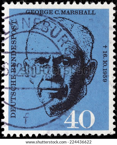 GERMANY - CIRCA 1960: A stamp printed by GERMANY shows an American general and statesman famous for his leadership roles during World War II and the Cold War George Marshall, circa 1960 - stock photo