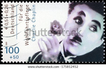 "GERMANY - CIRCA 2001: A stamp printed by GERMANY shows image portrait of famous English comic actor and filmmaker Sir Charles Spencer ""Charlie"" Chaplin, circa 2001 - stock photo"