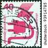 """GERMANY - CIRCA 1971: A stamp printed in Germany from the """"Accident Prevention"""" issue shows a faulty electric plug, circa 1971. - stock photo"""