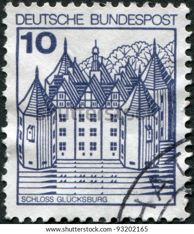 GERMANY - CIRCA 1977: A stamp printed in Germany, is shown Glucksburg Castle, circa 1977 - stock photo