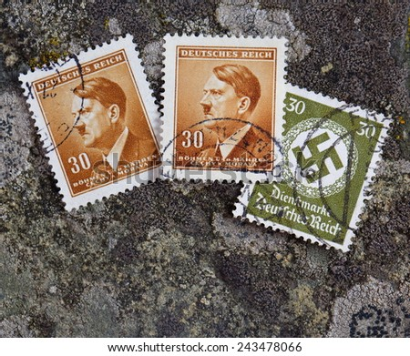 GERMANY - CIRCA 1937: A stamp printed in Germany shows image of Adolf Hitler an Austrian-born German politician and the leader of the Nazi Party, in red, circa 1937. - stock photo
