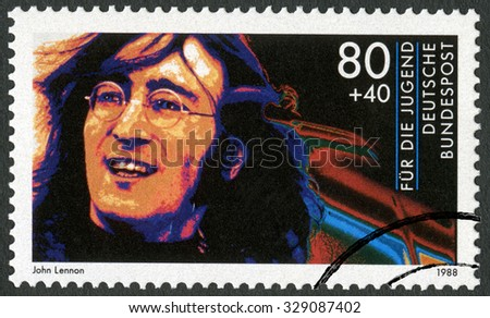 GERMANY - CIRCA 1988: A stamp printed in Germany shows John Winston Ono Lennon (1940-1980), series Rock Stars, circa 1988 - stock photo