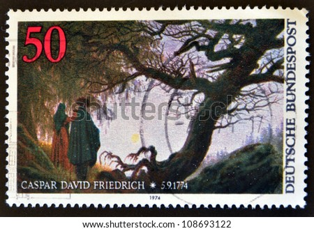 GERMANY - CIRCA 1974: a stamp printed in Germany shows Man and Woman Looking at the Moon, by Caspar David Friedrich, circa 1974