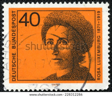 GERMANY - CIRCA 1974: A stamp printed in Germany shows Rosa Luxemburg (1871-1919), series Honoring German women writers and leaders in political and women's movements, circa 1974 - stock photo