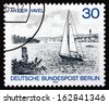 GERMANY - CIRCA 1976: a stamp printed in the Germany, Berlin shows Sailboat on Havel River, Berlin View, circa 1976 - stock photo