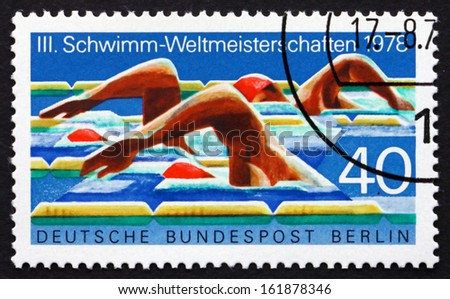 GERMANY - CIRCA 1978: a stamp printed in the Germany, Berlin shows Swimmers, 3rd World Swimming Championships, Berlin, circa 1978 - stock photo
