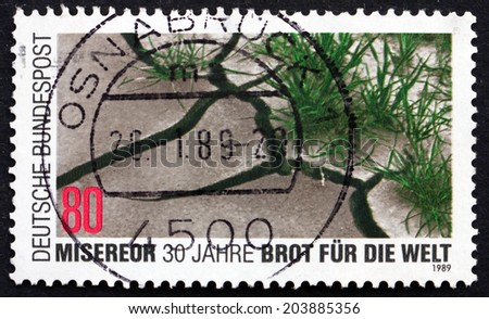 GERMANY - CIRCA 1989: a stamp printed in the Germany shows Barren and Verdant Soil, Church Organizations Helping Third World Nations, Misereor and Brot fur die Welt, circa 1989 - stock photo