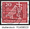 GERMANY - CIRCA 1960: a stamp printed in the Germany shows Dove, Chalice and Crucifix, 37th Eucharistic World Congress, Munich, circa 1960 - stock photo