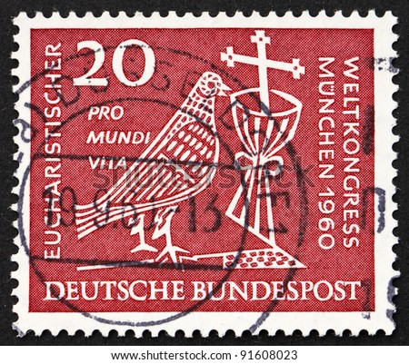 GERMANY - CIRCA 1960: a stamp printed in the Germany shows Dove, Chalice and Crucifix, 37th Eucharistic World Congress, Munich, circa 1960
