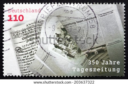 GERMANY - CIRCA 2000: a stamp printed in the Germany shows Einkommende Zeitungen, First Daily Newspaper, 350th Anniversary, circa 2000 - stock photo