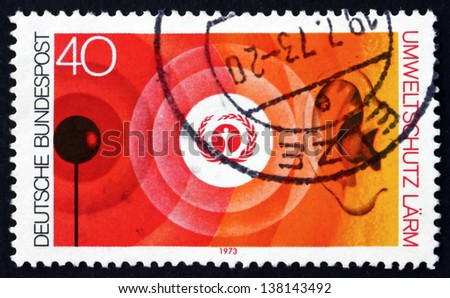 GERMANY - CIRCA 1973: a stamp printed in the Germany shows Environment Emblem and Noise Pollution, Nature and Environmental Protection, circa 1973 - stock photo