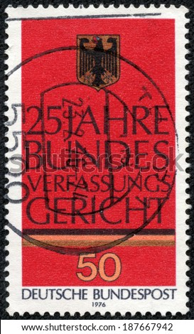 GERMANY - CIRCA 1976: a stamp printed in the Germany shows German Eagle, 25th Anniversary of Federal Constitutional Court, circa 1976