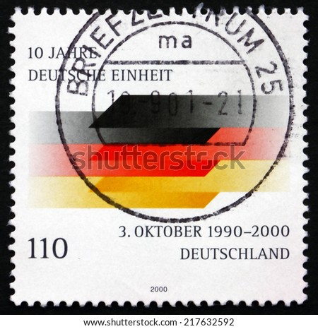GERMANY - CIRCA 2000: a stamp printed in the Germany shows German Flag, Reunification of Germany, 10th Anniversary, circa 2000 - stock photo
