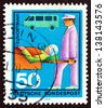 GERMANY - CIRCA 1970: a stamp printed in the Germany shows Stretcher Bearer, Casualty and Ambulance, honoring various voluntary services, circa 1970 - stock photo