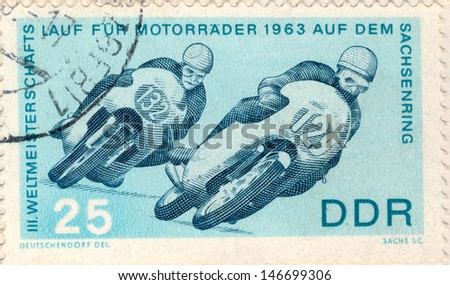 GERMANY - CIRCA 1963: An old used German Democratic Republic postage stamp issued in honor of the World Motocross Championship 1963; series, circa 1963 - stock photo
