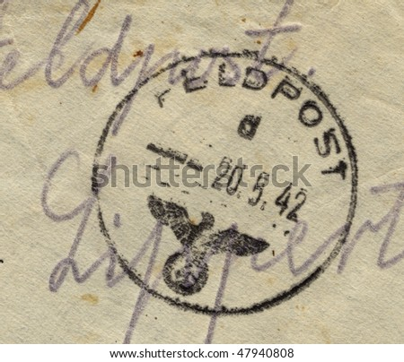 GERMANY - CIRCA 1942: Fieldpost postmark on the on vintage world war two envelope, germany circa 1942 - stock photo