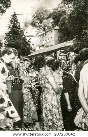 GERMANY, CIRCA FORTIES - Vintage photo of a big group of people outdoor