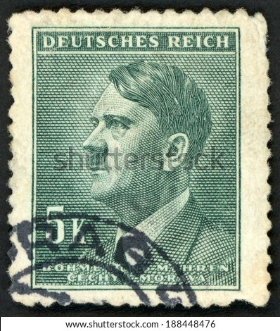 GERMANY - CIRCA 1942: post stamp printed in the Protectorate Czech and Morava shows portrait of Adolf Hitler (politician, leader of Nazi Party, dictator, veteran of World War), 5k green, circa 1942 - stock photo