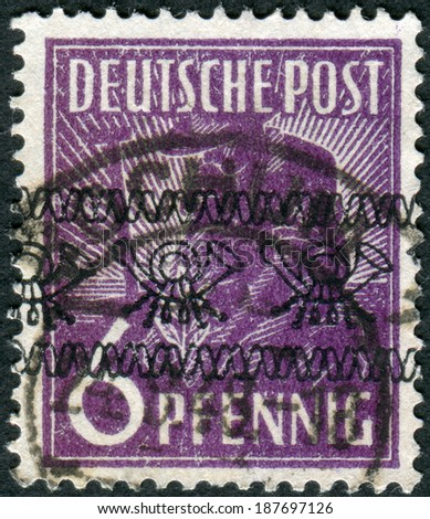 GERMANY - CIRCA 1947: Postage stamp printed in Germany (overpint Type A: US and British occupation zone), shows the Planting Olive, circa 1947