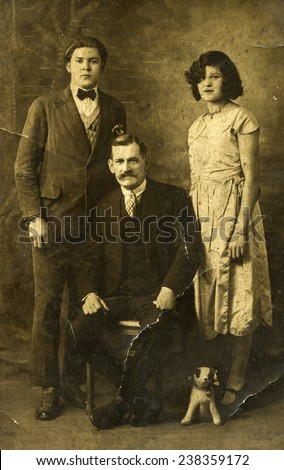 GERMANY, CIRCA 1930s- vintage photo of father with daughter and son - stock photo