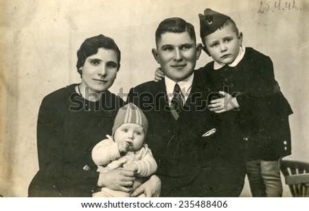 GERMANY, CIRCA 1940s: Vintage photo of parents with their children