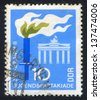 GERMANY - CIRCA 1968: stamp printed by Germany, shows Brandenburg Gate, Torch, circa 1968 - stock photo