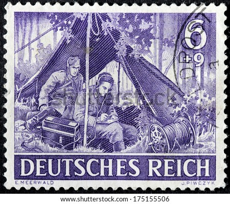 GERMANY - circa 1943: stamp printed by Germany, shows German signal corps soldiers,  circa 1943. - stock photo