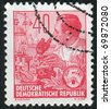 GERMANY - CIRCA 1953: Stamp printed by Germany, shows Laboratory worker, circa 1953 - stock photo