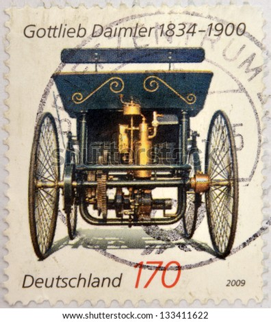 GERMANY - CIRCA 2009: Stamp printed in germany shows Gottlieb Daimler, old car, circa 2009 - stock photo